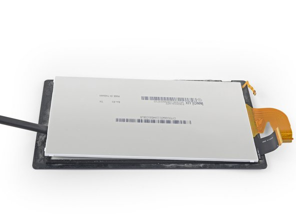 Insert the flat end of a spudger in between the LCD panel and the digitizer along the left edge of the screen assembly.