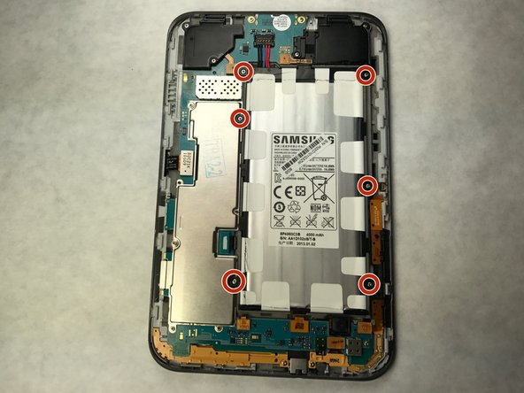 Using a phillips head screwdriver, remove the 6 4mm screws holding the battery on the device.