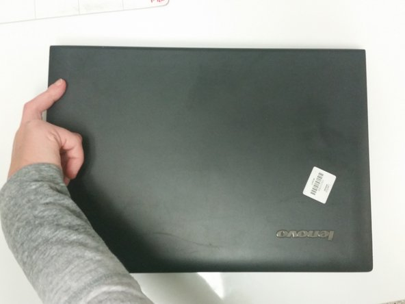 Flip the laptop over and open it as you would to use it.