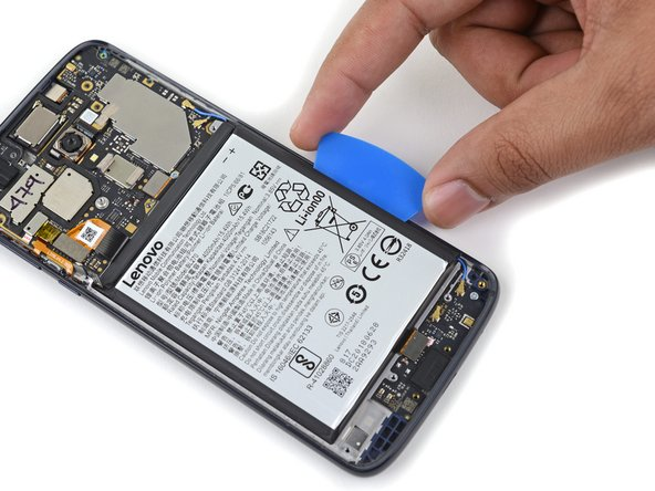 Use the pick to steadily pry the battery up.