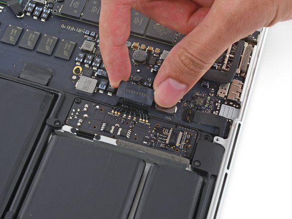 Bend the battery connector up out of the way to prevent accidental contact with its socket during your repair.