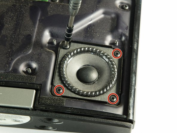 Remove the four 16mm #2 screws holding the speaker to the base using a #2 screwdriver