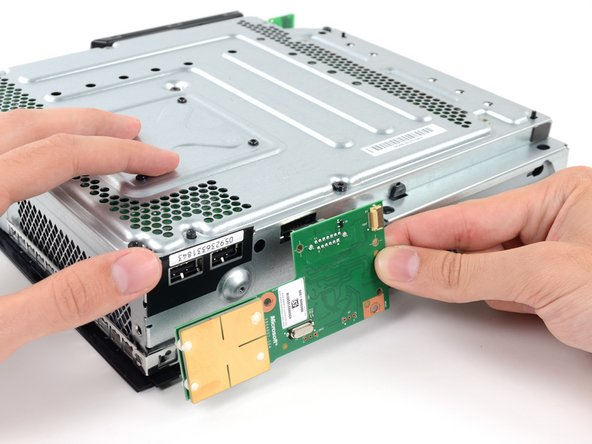 Unlike the hard drive, Microsoft redesigned, and even printed new stickers for, the Xbox 360 E's RF module.