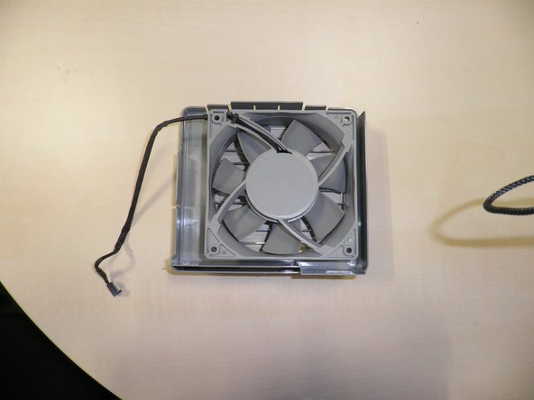 right fan in processor cage. Remember, two clips to take the a fan apart. Top and Bottom.
