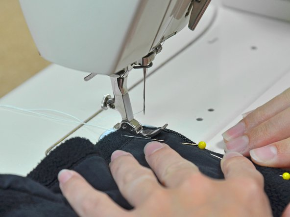 Replace the zipper foot in your machine.