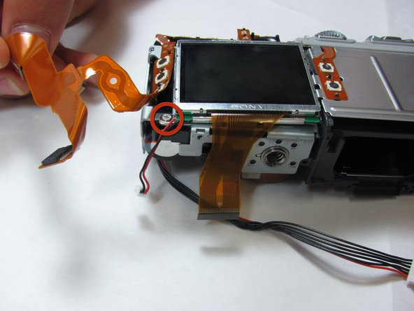 Remove the 3.3mm screw on the bottom left of the LCD screen.