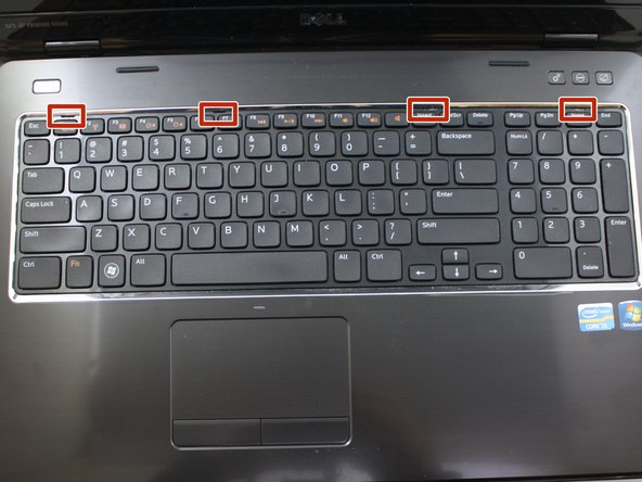 Do not pull the keyboard away from the laptop.  The keyboard is connected to the motherboard by a cable.  Pulling the keyboard may cause damage to the keyboard and/or motherboard.