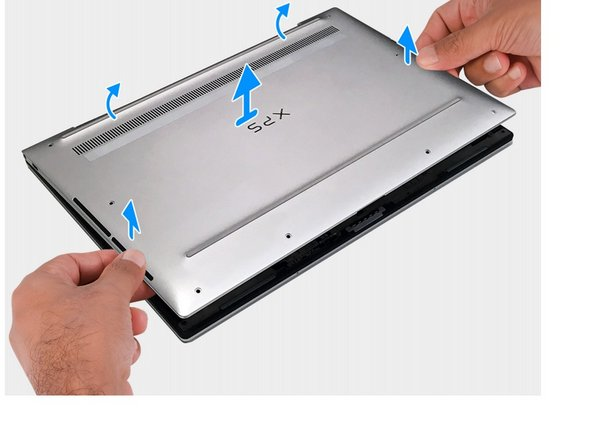 Hold both sides of the base cover and lift to remove the base cover from the laptop.
