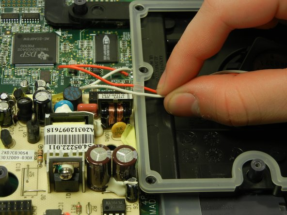 Remove the red and white wires from the rubber casing rim.