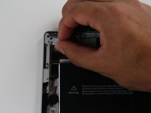 Carefully remove the gray headphone jack.