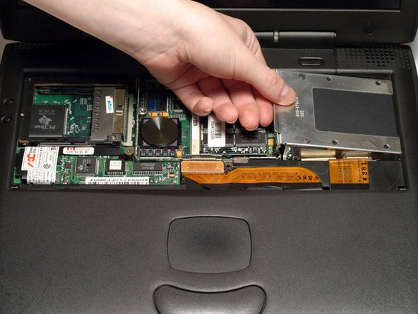 Grasp the hard drive bracket on the left side and pull up and to the left.