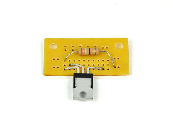 Insert the leads of the 390 Ω resistor through the holes indicated in step 7. This resistor will have an orange, grey, brown and gold band on it. The direction of the resistor does not matter.