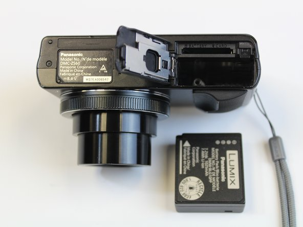 Remove the battery by sliding it out from the camera.