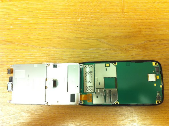 I then folded the metal plate over the bottom of the phone.