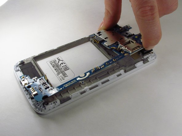 Use your finger to lift the motherboard from the edge and remove it from the phone.