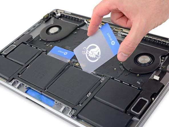 Retrieve your second plastic card and repeat the previous step to separate the remaining center battery cell.