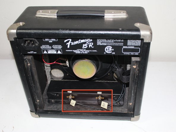 There will be two black wires connecting the top mounting bracket to the reverb box at the bottom of the unit. Label the wires to prevent crossing upon re-installation, then unplug the wires from the reverb box.