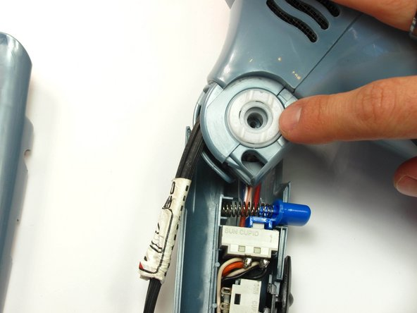 Remove the inner white disk piece by gently pulling it out with your finger nail.