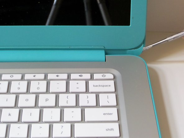With the laptop facing you, open the clamshell. Be sure to turn the power off using a long press before beginning.