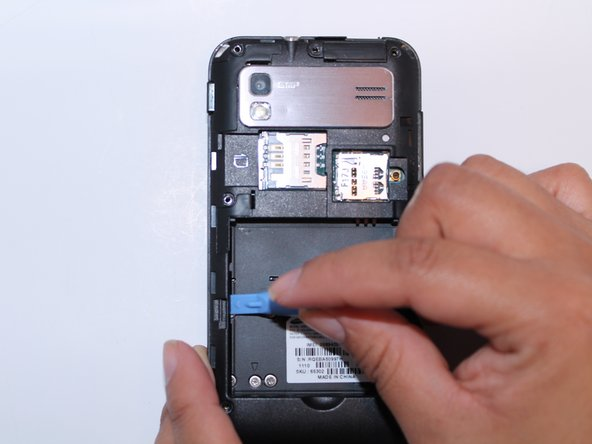 Remove the back plate using the plastic opening tool.