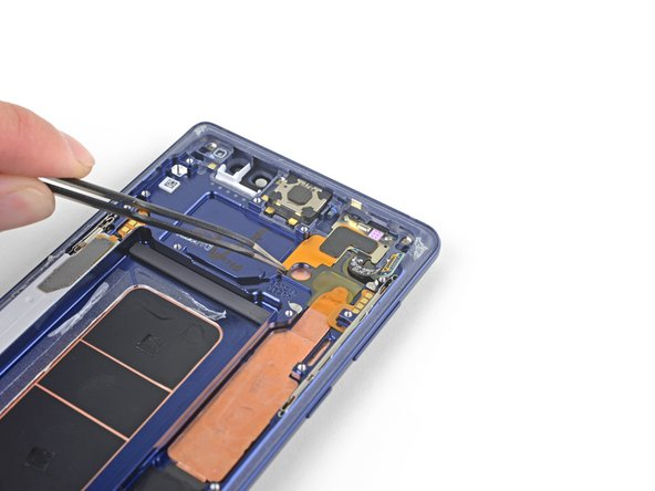Use a pair of tweezers to peel back the adhesive-backed copper foil.