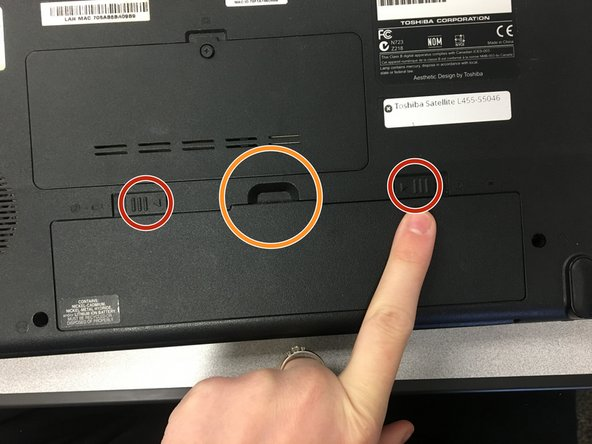 Find the battery on the back of the computer. Slide both tabs outward towards the side of the laptop and the battery will come loose.