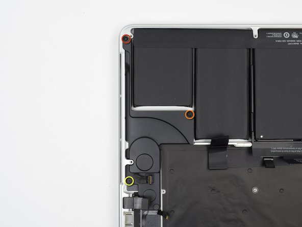 Remove the following three screws securing the left speaker to the upper case: