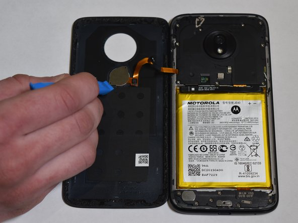 Use the iFixit pick and the iFixit opening tool to pull the fingerprint scanner off of the back case.