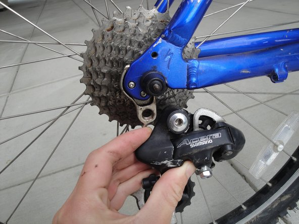 Bolt the derailleur to the mounting tab with an Allen wrench.