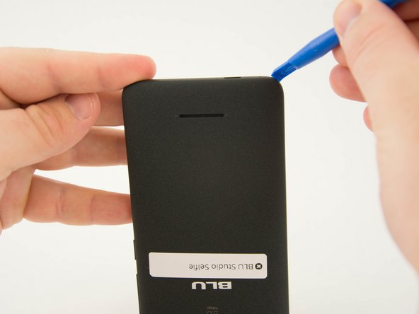 Insert the flat end of your plastic opening into the crevice you found along the side of the phone.