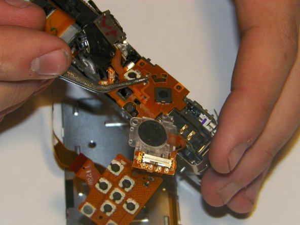 Grip the top control board with the tweezers and gently pull up to unseat it from the placement pins it sits on.