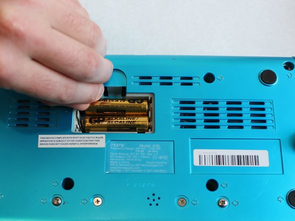 With the battery panel off, remove the batteries. Use your hands or a plastic spudger to remove the batteries.