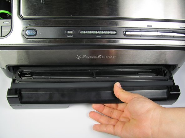 Open the drawer on the bottom side of the FoodSaver first.