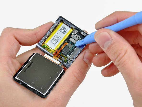 Use an iPod opening tool to disconnect the display data and digitizer cable connectors up from their sockets on the logic board.