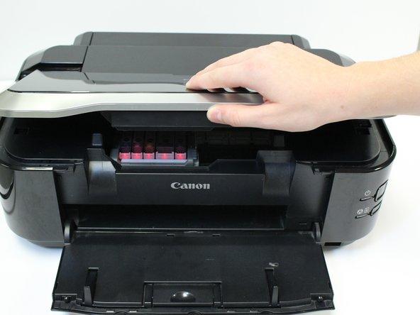 Lift the printer lid.