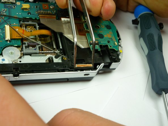 The speakers should slide out fairly easily; it may be helpful to use tweezers to begin prying them out.