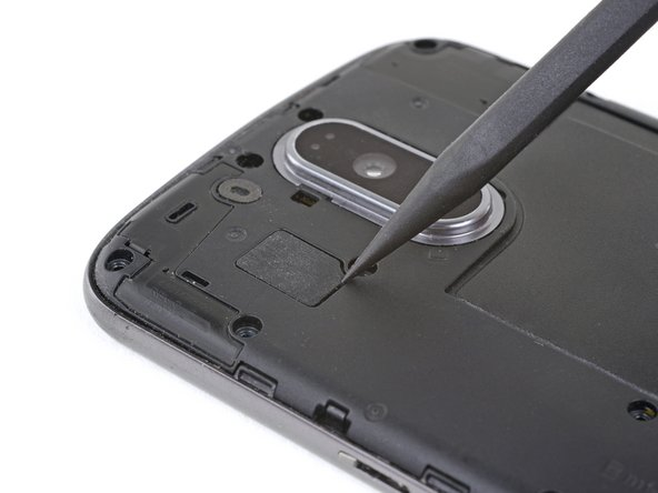 Use the point of a spudger to pry up the rubber cover over the camera flash connector.