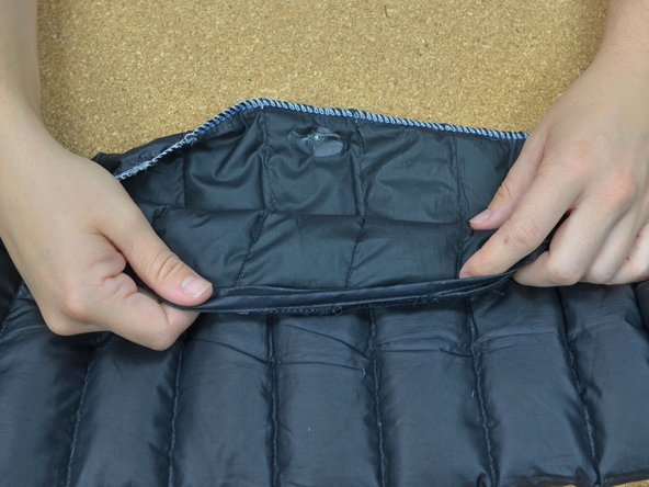 Turn the jacket inside out.