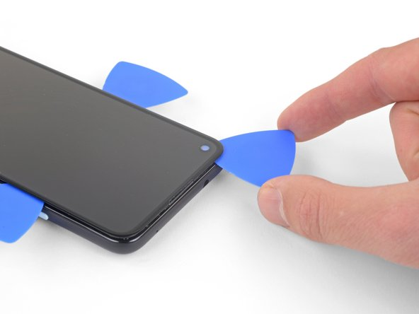 Insert another opening pick into the left edge of the phone at an angle where a gap has already formed to prevent damage to the OLED panel.