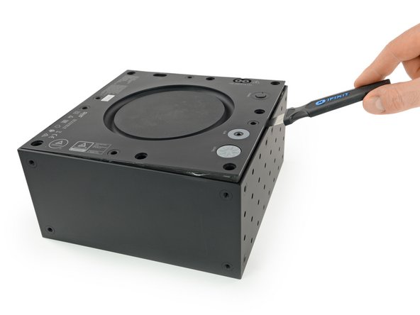 We tackle the woofer first and again find some rubber plugs hiding the screws on the back. Having a Jimmy at hand makes the prying much easier since there is no bass reflex vent to get a hold on.