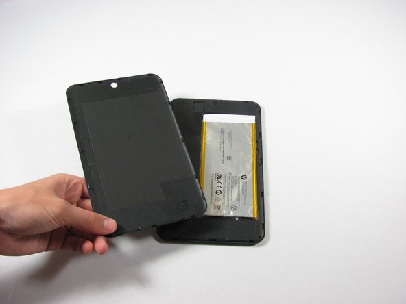 Slide your finger around the rest of the back cover, lifting it completely off of the device.