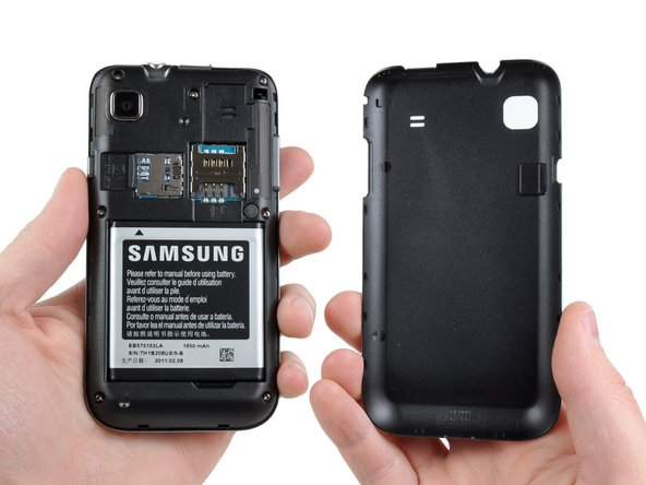 Well lookie lookie...what have we here? The rear panel is easily removed, revealing both SIM and microSD card slots, as well as what seems to be a replaceable battery!