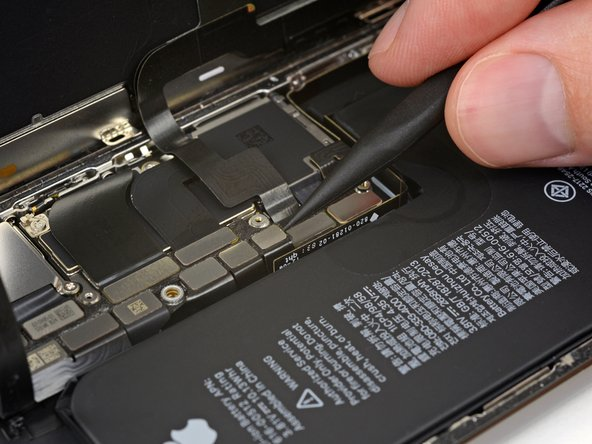 Use a spudger or a clean fingernail to pry the battery connector up from its socket on the logic board.