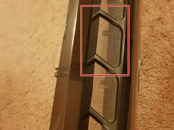 Clean the front panel dust filter using a tissue or a cloth.