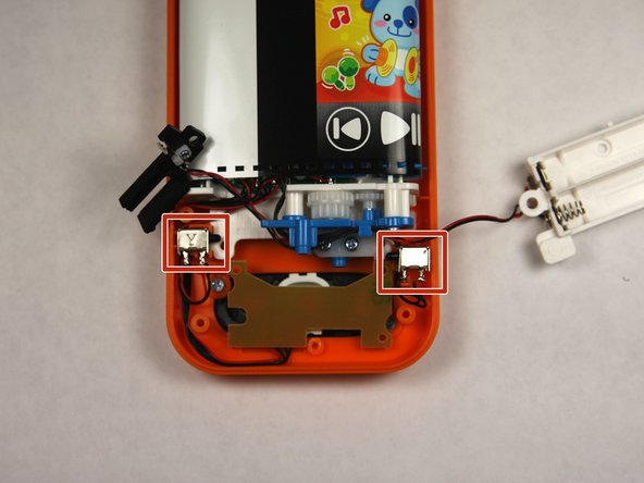 Remove the two buttons, noting how wires are placed for reassembly.