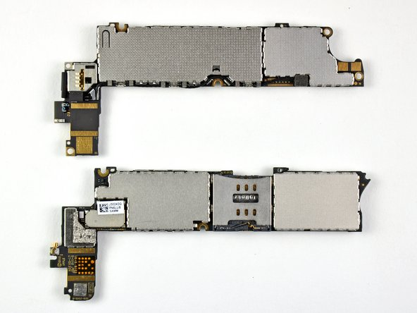 Verizon iPhone 4 logic board on top.