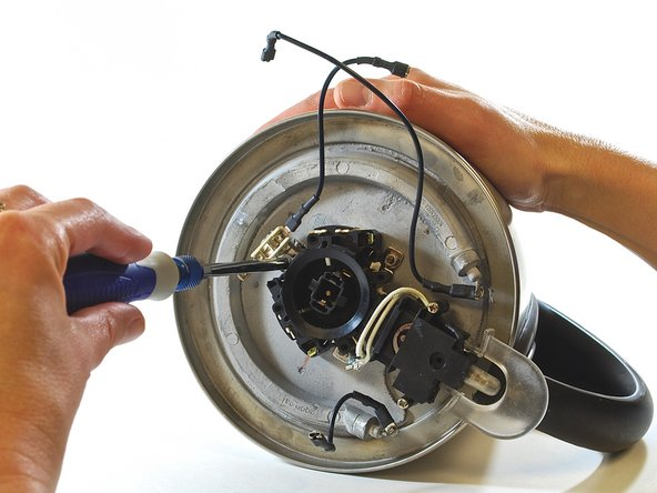 "Using a 7/32"" nut driver, remove the hex nut that secures the power supply to the base of the kettle."