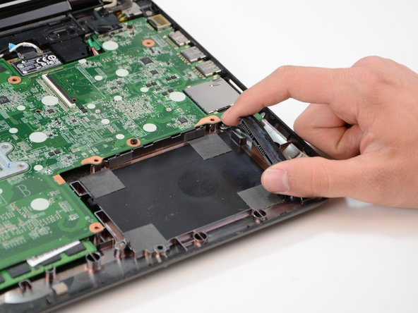 Detach and remove the hard drive from the black plug located to the right of the hard drive.