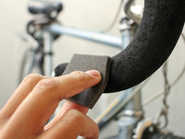 Lightly sand down the handlebar with the sandpaper.