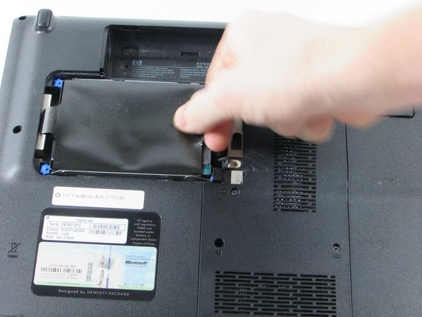 Pull the Hard Drive to the right  to loosen the it from the frame.